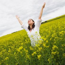 600-01042430 © Marnie Burkhart Model Release: Yes Property Release: No Model Release Woman Standing in Canola Field, Alberta, Canada